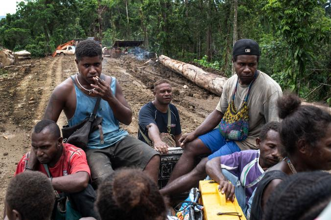 Locals who work for a different logging company than Gallego are transported up the mountain to the camp. Image by Monique Jaques. Solomon Islands, 2020.